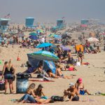 People crowd Southern California beaches despite coronavirus concerns