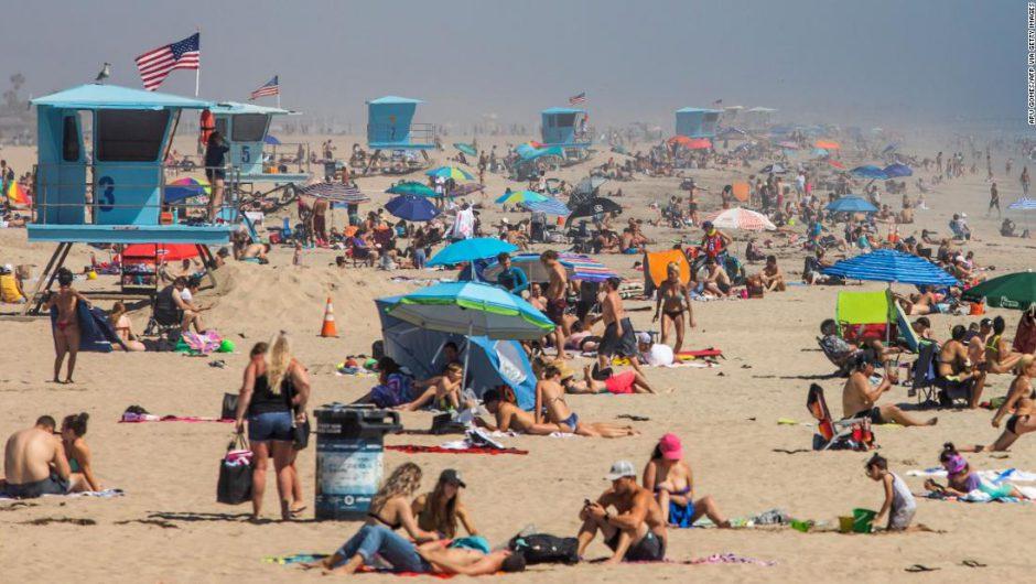 People crowd Southern California beaches despite coronavirus concerns