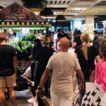 Crowds swarm to shopping centres as coronavirus restrictions begin to ease, causing alarm over lack of social distancing