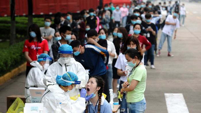 Coronavirus update: Wuhan conducts 1.4m tests in one day, Trump returns to golf links, far-right protests in Spain