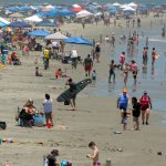 US coronavirus: As Americans flock to beaches and parks, some states see surges in new coronavirus cases
