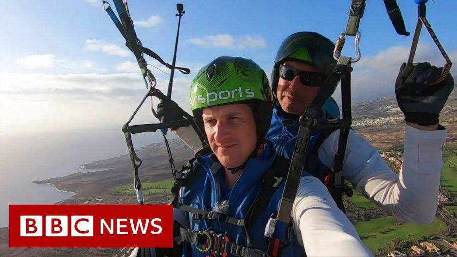 Paragliding over Tenerife's coronavirus-hit hotel – BBC News