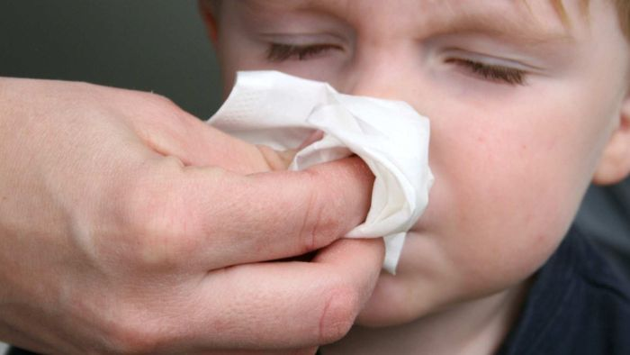 Do I need to get my family tested for coronavirus every time one of us has a runny nose this winter?
