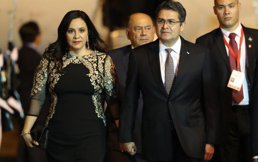 Honduras says its president has been hospitalized with COVID-19. Many don't believe it