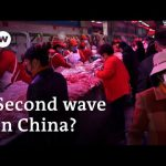Dozens of new coronavirus cases tracked to Beijing food market | DW News