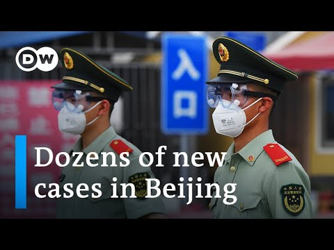 Beijing on partial lockdown after new coronavirus cluster emerges   DW News