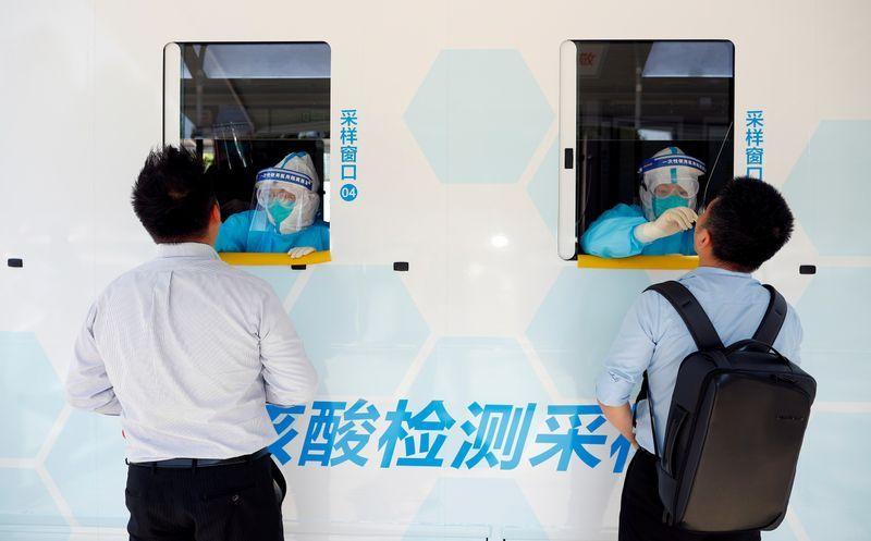 Second wave of coronavirus in Asia prompts fresh lockdowns