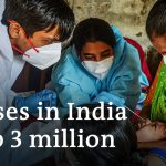 Coronavirus India: Workers flee cities as case numbers soar | DW News