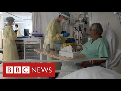 Hospitals under pressure again as Covid admissions rise sharply – BBC News