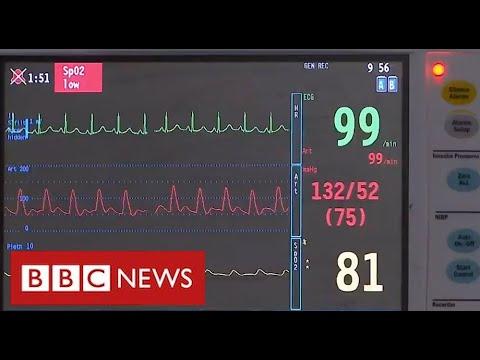 Huge pressure on hospitals as coronavirus cases surge – BBC News