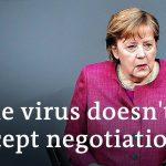German lawmakers debate national COVID 'emergency brake' | DW News