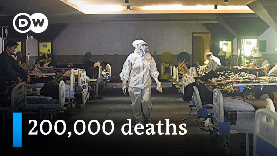 India's official death toll surges past 200,000 as the country's healthcare system collapses